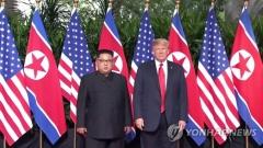 김정은 '인민복'-트럼프 '붉은 넥타이·정장'…드레스코드 '눈길'